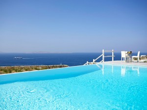 View of the Aegean sea as seen from a table by the private pool of the Mykonos Ammos Superior Villa.
