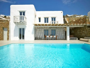The Mykonos Ammos Villa in Houlakia is a two level luxury accommodation with a pool and pergola.