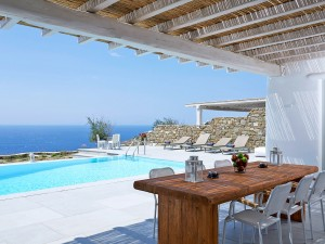 The Mykonos Ammos Villa private pool and sitting lounge with a stunning view of the Aegean sea.