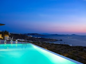 Sunset over Houlakia as seen from the Mykonos Ammos Villa private pool
