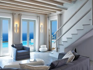Inside the Luxury 2 level Mykonos Ammos Superior Villa. Sitting room with panoramic view of the sea.