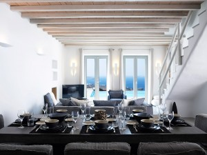Mykonos Ammos Superior Villa Dining table & Sitting room. The dining table can accommodate 8 people