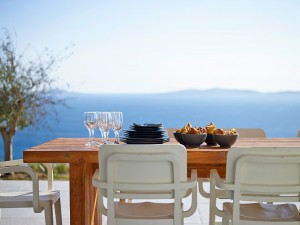 Amazing view of the Aegean sea when sitting at the table under the Mykonos Ammos Villa pergola.