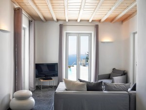 The sitting room area of the one of the Mykonos Ammos Villas. It offers all comforts plus sea view.