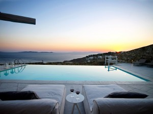View of the sea as seen from the private pool of the Luxury Mykonos Ammos Villa in Houlakia at dusk.