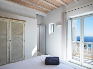 One of the bedrooms of the Ammos Villas in Houlakia. A view of the sea can be seen from the window.