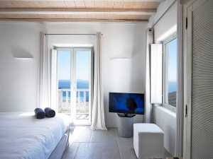 The Mykonos Ammos Villa bedrooms are equipped with Flatscreen TV, double bed and panoramic sea views