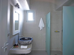 The Mykonos Ammos Villa bathrooms, are equipped with showers, basins, large mirrors and all comforts