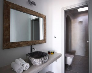 The Mykonos Ammos Villa bathrooms, are equipped with fresh towels, basins, large mirrors and more.