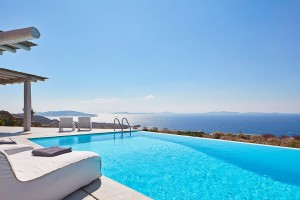 View of the sky, sea & islands from luxury sunbeds by the private pool of the Ammos Villa in Mykonos