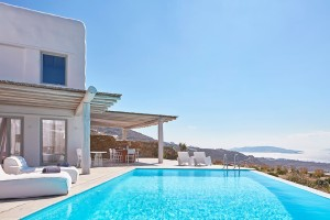 External shot of the Mykonos Ammos Villa, private pool, outdoor veranda & sea view at Houlakia