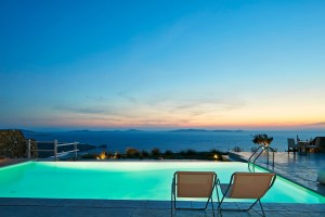 Sunset sea view seen from the private pool at the luxury Villa at Mykonos Ammos Villas in Houlakia