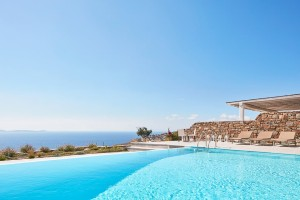 Private pool & sunbeds of the luxury Mykonos Ammos Villa in Houlakia, with expansive view of the sea