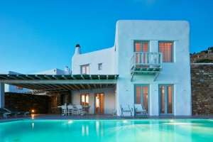 Exterior of Mykonos Ammos Villas luxury Superior Villa & private pool in Houlakia, Mykonos at dusk