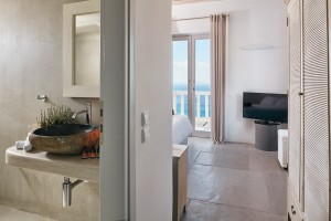 Luxury Mykonos Ammos Villa modern design bathroom, & bedroom with TV & sea view balcony in Houlakia