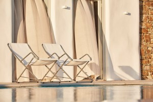 Deckchairs in front of the luxury sea view Villa at Mykonos Ammos Villas beside the private pool