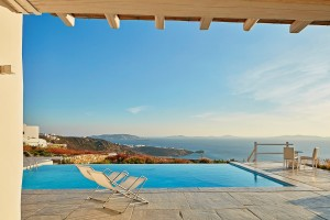 Deckchairs & chairs at Mykonos Ammos Villas Superior Villa sea view private infinity pool in Mykonos