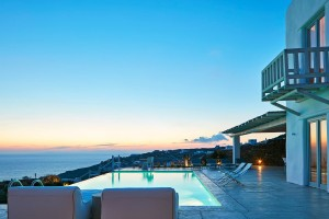 Sunset view over the sea & Mykonos seen from luxury Superior Villa private swimming pool in Houlakia