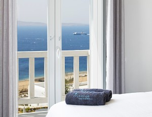 Stunning view of the Aegean sea surrounding Mykonos, as seen from one of the Ammos Villa bedrooms.